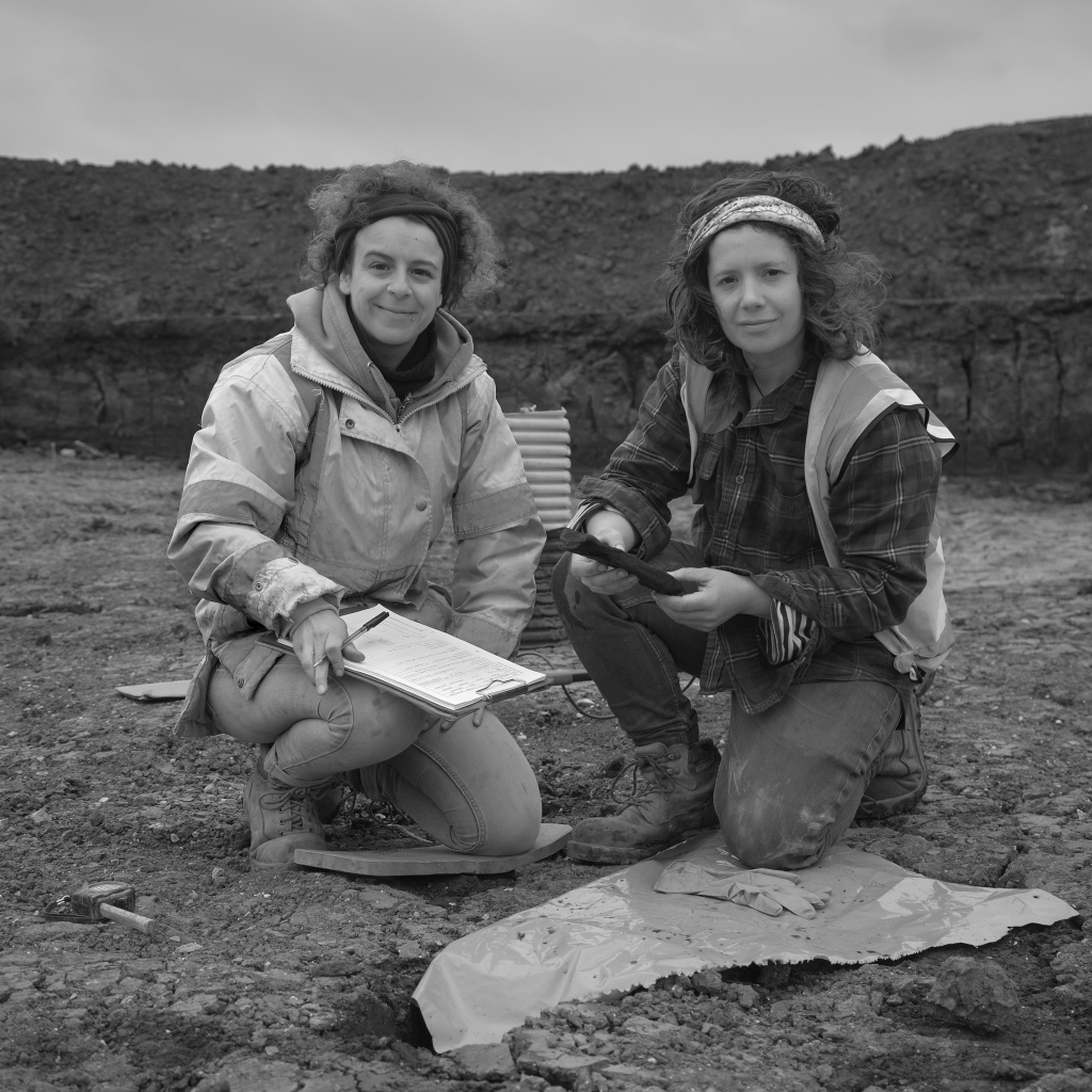 Photograph  of Sara and Lizzie at archaeological excavation Over Cambridgeshire May 2019